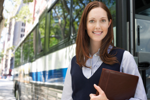 Young Woman by Bus Holding Daily Planner